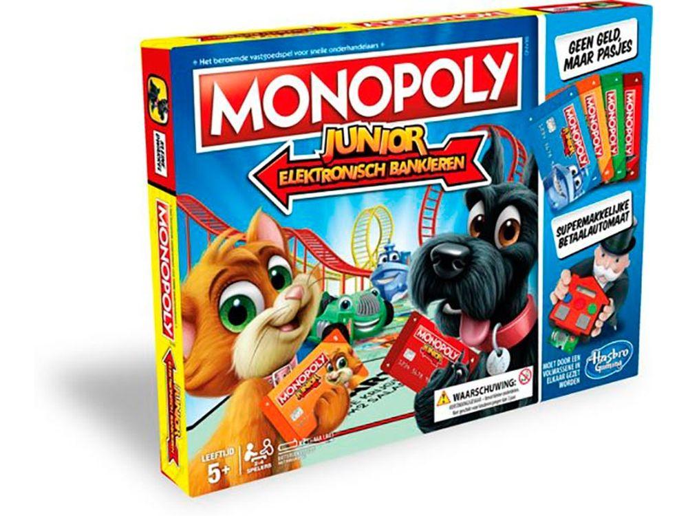 Afbeelding van Het klassieke Monopoly Junior spel heeft een nieuw jasje: Elektronisch Bankieren! Het biedt kinderen een eigentijdse bankervaring omdat het geld is vervangen door een elektronische bankautomaat en door Monopoly bankpasjes. Gebruik de pasjes om vakjes te k